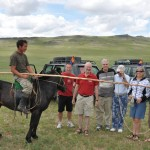 Nomad herder makes an appearance during our picnic lunch - Mongolia