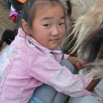 Mongolian girls learn to milk goats at early age