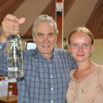 Dave Riddoch receives birthday present of excellent vodka from our guide Tatiana - Kharakhorum, Mongolia