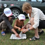 Gillian helps herder child colour - Mongolia