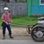 Russian boy fetching water from village well