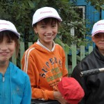 Happy Russian children with new Canada hats