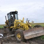 Motor grader working on Trans-Siberian Highway