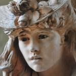 Famous sculpture by Rodin of girl with fancy bonnet