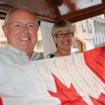 Terry and Ellen unfurl Canadian flag