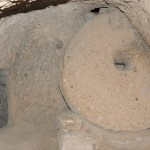 Underground; notice round 'millstone' door rolled to seal entrance to chamber - Cappadocia, Turkey