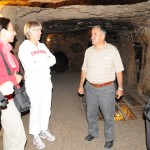 Touring underground cave and tunnel complex - Cappadocia, Turkey