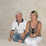 Russ and Ellen sit at monk's long underground dining table - Cappadocia, Turkey