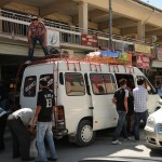 Passengers loading market day purchases on bus - Turkey