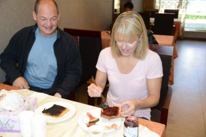 Mitch and Kirsten enjoy toast and jam for breakfast (note use of chopsticks; no knife) - Shigatse, Tibet