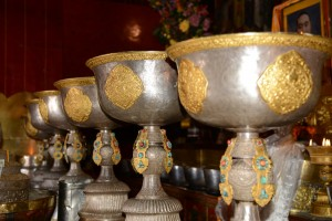 Ornate bowls (always in groups of seven) holding holy water; Tashilunpo Monastery - Shigatse, Tibet