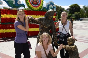 Posing at bronze statue display - Shigatse, Tibet