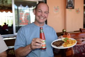 Mitch enjoys ketchup and yak burger for lunch - Shigatse, Tibet