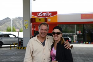 Tyler and Ellen (brother and sister) at gas station (note  Chinese company slogan) - Tibet