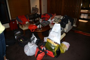 Luggage in our room (a mess to be sorted) - Lhasa, Tibet