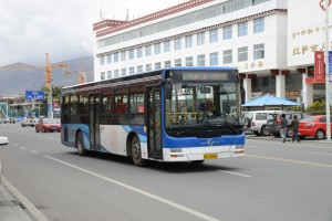 Modern buses and buildings - Lhasa, Tibet