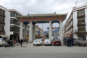 Ornate archway; street access to central square - Lhasa, Tibet